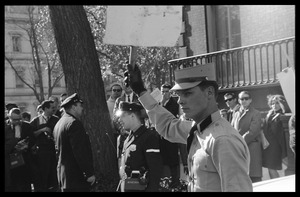 Thumbnail of American Nazi Party counter-protester, Douglas L. Niles, in uniform, carrying a sign: Washington Vietnam March for Peace
