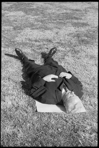 Thumbnail of Man lying on the grass during the demonstration: Washington Vietnam March for Peace