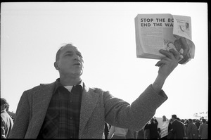 Thumbnail of Protester handing out antiwar literature, 'Stop the bombing. End the war now!': Washington Vietnam March for Peace