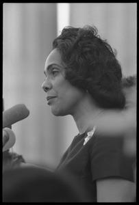 Thumbnail of Coretta Scott King addressing the Solidarity Day crowd at the Poor People's             March on Washington, speaking against the War in Vietnam Portrait in profile, at the microphones