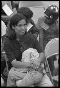 Thumbnail of White woman in the Solidarity Day crowd at the Poor People's March on             Washington, hugging an African American child while Coretta Scott King speaks
