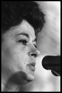 Thumbnail of Unidentified woman: close-up portrait, speaking at a podium