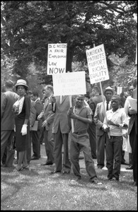 Thumbnail of Young protesters holding signs demanding racial equality and fair employment in             Washington, D.C. Signs read 'American patriots support racial equality NAACP' and 'DC needs a             fair employment law now'