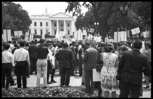 Thumbnail of Civil rights protesters with signs demanding fair housing gathered at a             demonstration in front of the White House