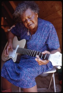 Thumbnail of Older woman in tent playing an electric guitar, Resurrection City encampment