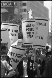 Thumbnail of Antiwar protesters during the March on Washington carrying signs 'Freedom             now in Vietnam,' 'War on Poverty, not on people,' and 'I won't fight in Vietnam'