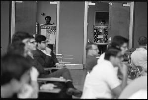 Thumbnail of Protesters outside the Selective Service College Qualification examination to             determine eligibility for an educational deferment from service in the Vietnam War:             'Taking the test says Let the dummies die.. in Vietnam'
