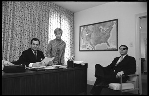 Thumbnail of Michael O'Harro (right) at his desk in the JOPA club office
