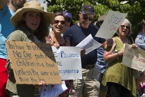 Thumbnail of Pro-immigration protesters and signs outside the Chatham town offices building : taken at the 'Families Belong Together' protest against the Trump             administration's immigration policies