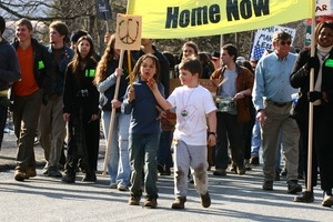 Thumbnail of Children at the head of the march with a sign decorated with a peace symbol: rally and march against the Iraq War