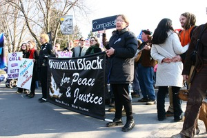 Thumbnail of Marchers holding a banner for 'Women in Black for Peace and Justice': rally and march against the Iraq War