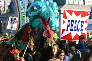 Thumbnail of Anti-war marchers, dragon puppet, and 'Peace' signs: rally and march against the Iraq War