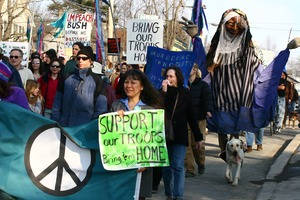 Thumbnail of Anti-war marchers with peace banner, dog, and grotesque puppet: rally and march against the Iraq War