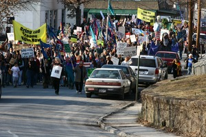 Thumbnail of Anti-war marchers in the streets, led by banner reading             'Bring the troops home now': rally and march against the Iraq War