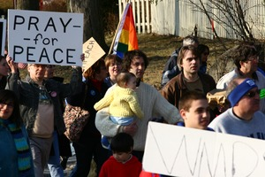 Thumbnail of Anti-war protesters, one carrying and infant, and sign reading 'Pray for peace': rally and march against the Iraq War