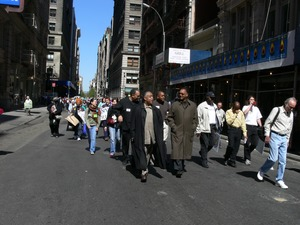 Thumbnail of Jesse Jackson and Al Sharpton (center) at the head of a group protesters             marching down East 17th Street Taken during the March for Peace, Justice and Democracy