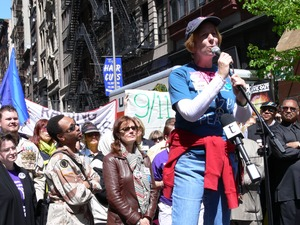 Thumbnail of Cindy Sheehan speaking during the march opposing the War in Iraq (Susan Sarandon         in the background center, and Jesse Jackson, right) Taken during the March for Peace, Justice and Democracy