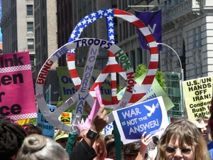 Thumbnail of Antiwar marchers in the streets of New York with signs and banners opposing the             war in Iraq, 'Bring the troops home now' Taken during the March for Peace, Justice and Democracy
