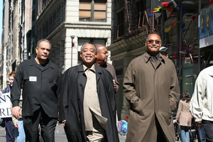 Thumbnail of Jesse Jackson (buttoned coat) and Al Sharpton leading the march opposing the war in             Iraq Taken during the March for Peace, Justice and Democracy