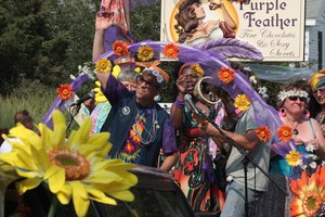 Thumbnail of Purple Feather chocolate shop float in the parade : Provincetown Carnival parade