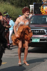 Thumbnail of Parade marcher in dress with a furry hem : Provincetown Carnival parade