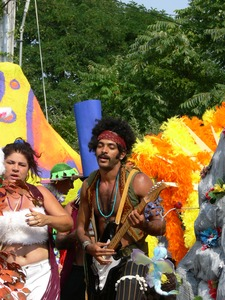 Thumbnail of Parade marcher with electric guitar, dressed after Jimi Hendrix : Provincetown Carnival parade