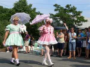 Thumbnail of Parade marchers in pastel gingham dresses and parasols : Provincetown Carnival parade