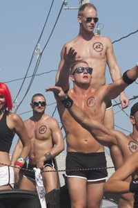 Thumbnail of 42 Below vodka float, with buff young men and women in skimpy outfits  : Provincetown Carnival parade