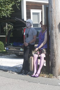 Thumbnail of Couple standing next to a telephone pole, one dressed like Andy Warhol : Provincetown Carnival parade