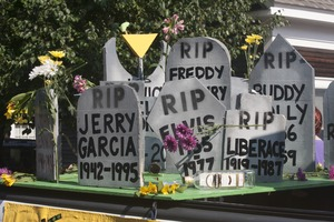 Thumbnail of Parade float with tombstones of deceased musicians (Jerry             Garcia, Elvis, Liberace, Freddy Mercury, Buddy Holly)  : Provincetown Carnival parade
