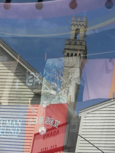 Thumbnail of Reflection of the Pilgrim Monument in a store window on Commercial Street, Provincetown