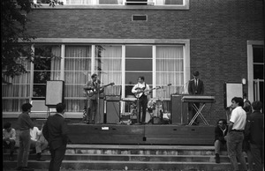 Thumbnail of Boss Tweeds at a picnic outside the Student Union Band playing on patio out the Union