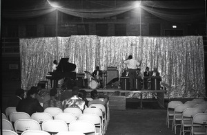 Thumbnail of Wilson Pickett rehearses his band before concert in Curry Hicks Cage Pickett with back to camera, facing band