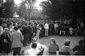 Thumbnail of Spectators at picnic outside Student Union View toward South College