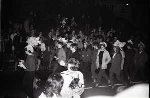 Thumbnail of Homecoming Parade (versus the University of Rhode Island) Kappa Kappa Gamma Sorority (sorority sisters parading down street)