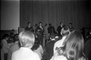 Thumbnail of SENDOFF event (Student Union Ballroom) The Pilgrims on stage: view over crowd with Lennie Baker (vocals and sax)