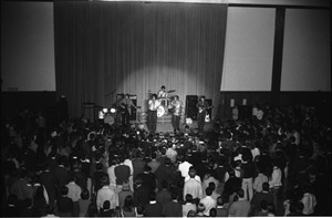 Thumbnail of SENDOFF event (Student Union Ballroom) The Turtles on stage: whole band with Flo Volman and Howard Kaylan at front,             Jim Pons (bass), John Barbata (drums), and Al Nichol (guitar)