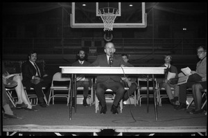 Thumbnail of Mark Noffsinger (Associate Dean of Students, UMass Amherst) makes opening remarks at open             meeting with school administration, Curry Hicks Cage, regarding protests against war in Vietnam