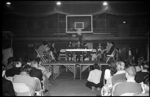 Thumbnail of Mark Noffsinger (Associate Dean of Students, UMass Amherst) speaking at open             meeting with school administration, Curry Hicks Cage, regarding protests against war in Vietnam