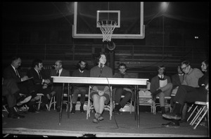Thumbnail of Helen Sullinger (student, UMass Amherst) makes a statement of students'             viewpoint at open meeting with school administration, Curry Hicks Cage, regarding protests against war in Vietnam