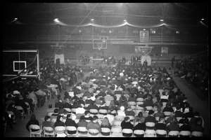 Thumbnail of Open meeting with school administration, Curry Hicks Cage, regarding protests against war in Vietnam View of the crowd in the Cage
