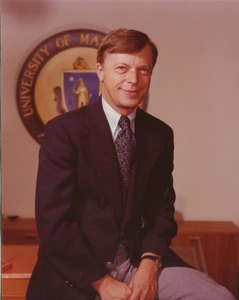 Thumbnail of David C. Knapp sitting on edge of desk