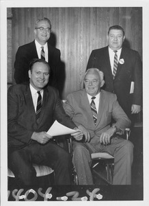 Thumbnail of John W. Lederle standing indoors with three unidentified men of the             Massachusetts House Ways and Means Committee