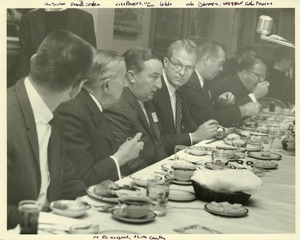 Thumbnail of John W. Lederle seated at a function with Frank Boyden, John Powers, John             Donovan, and Fr. Powers.
