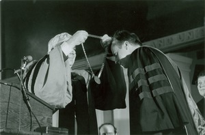 Thumbnail of David C. Knapp receiving medal from unidentified man