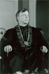 Thumbnail of David C. Knapp seated in chair with academic regalia