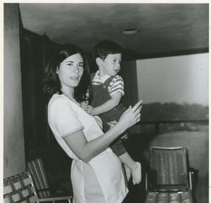 Thumbnail of Cindy Olken, standing, holding male child