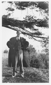 Thumbnail of Frederick Troy standing under a tree limb
