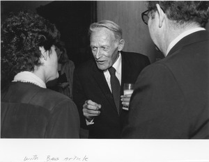 Thumbnail of Frederick Troy indoors talking with two unidentified people
