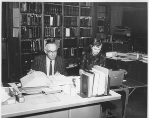 Thumbnail of Martin Hubbard and Joyce Merriam at reference desk in Goodell addition